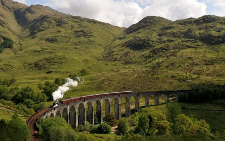 Jacobite steam train crossing Glenfinnan viaduct